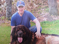 Kevin Laski at home with one of his beloved Leonberger dogs, Zandor.