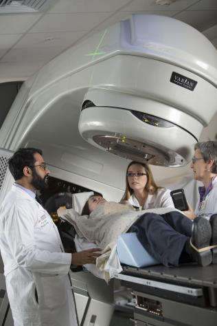 Dr. Kapadia providing radiation oncology treatment