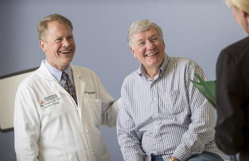Radiation Oncologist, Alan Hartford, MD, with his patient, William Handy.